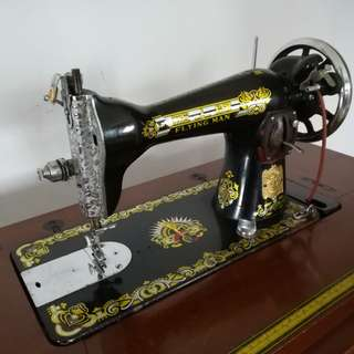 Antique Sewing Machine - Flying Man Brand