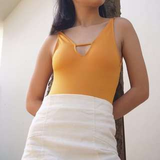 One piece mustard yellow swimsuit/ body suit (w/ pads)