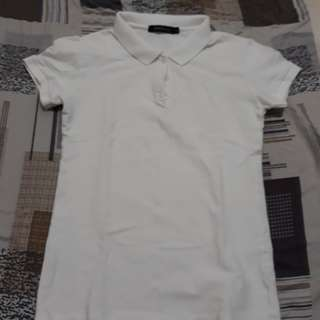 Folded and Hung White Polo Shirt