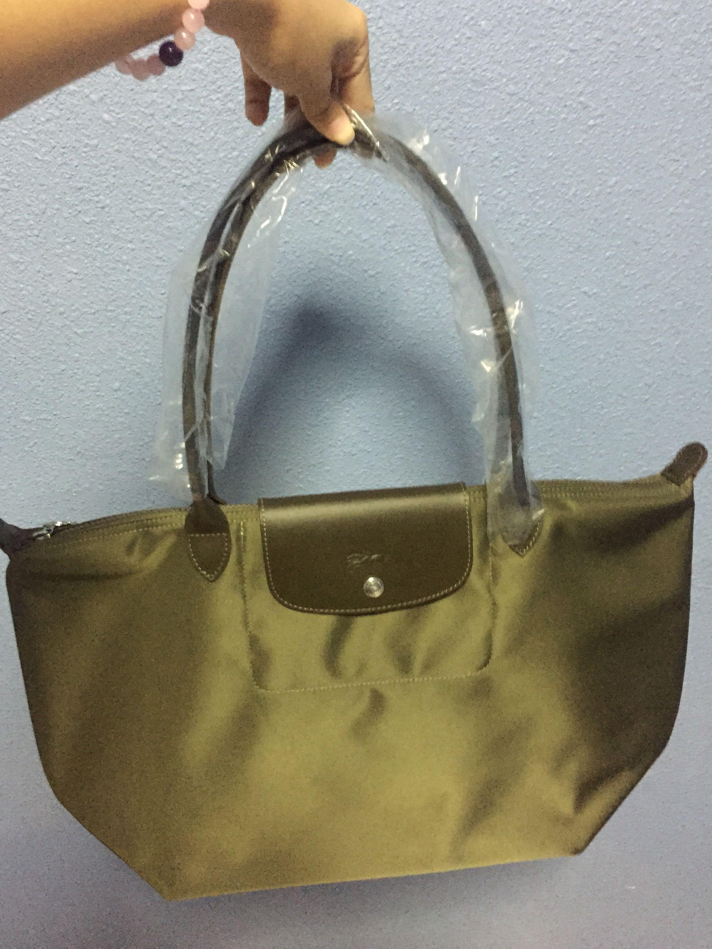 6cf39e3a637 Longchamp Le Pliage khaki Olive Green (Medium), Women's Fashion, Bags &  Wallets on Carousell