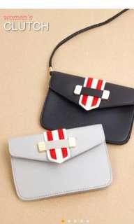 Women's clutch with strap
