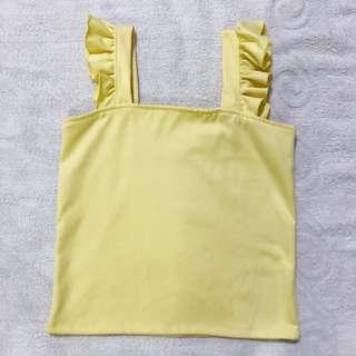 Yellow ruffled sleeveless top