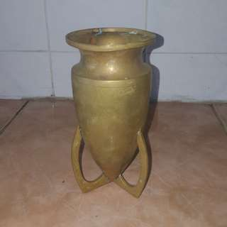 Antique brass bullet vase