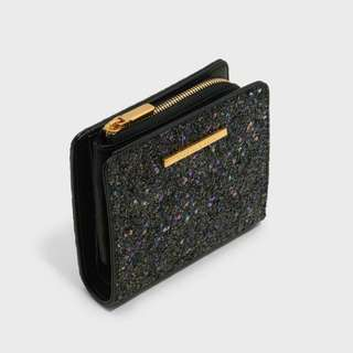 CHARLES & KEITH - Bags. Black textured square wallet with snap button closure