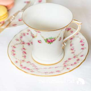 Mix and match antique English coffee can and saucer, hand-decorated rose swags, pale green polka dots, garlands