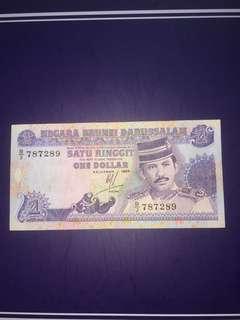 Brunei $1 year 1989