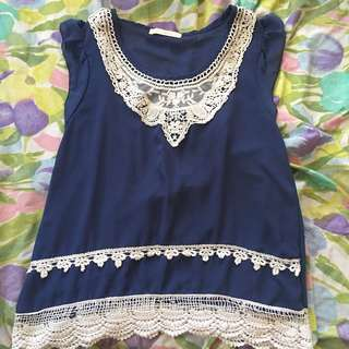 Sleeveless Blue Blouse