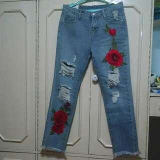 Ripped Jeans With Flower Patches