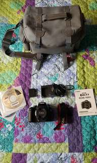 Canon 1100d DSLR with 50mm lens and bag