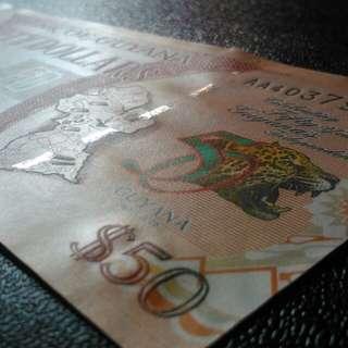 建國五十年紀念鈔 2016年 圭亞那 - AA版全新直版 UNC 微縮防偽/雕刻版/金屬線/螢光墨