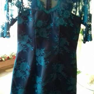 Lace dress in turquoise color
