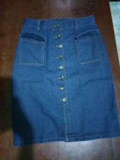 Long denim button down skirt .