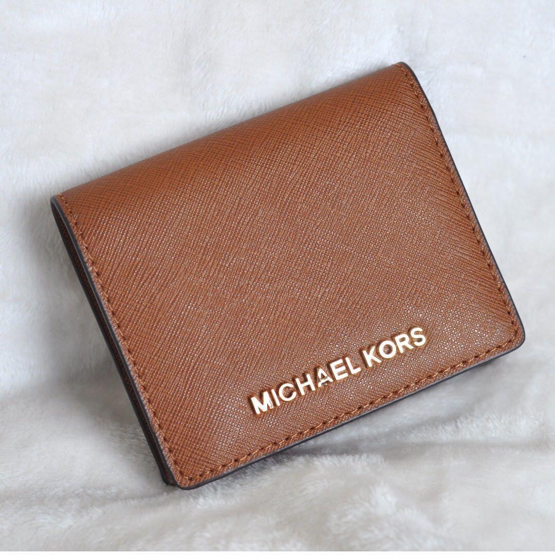 324552b3d066 MICHAEL KORS Jet Set Travel Bi-Fold Brown Saffiano Leather Wallet ...