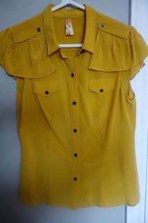 Yellow silk blouse from Anthropologie