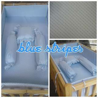 Baby crib bumper with pillows