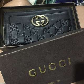 Gucci and MK wallet