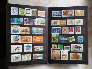 郵票簿連8頁世界郵票(已蓋印)