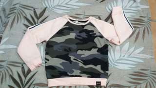 Pre-loved camouflage sweater.