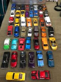 Various die cast cars sold at 100 each