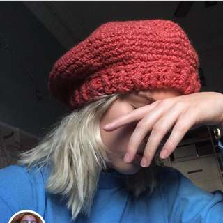 Knitted red beret style beanie