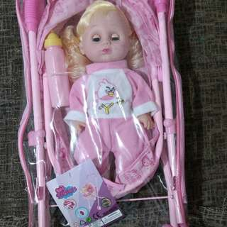 Baby stroller with cute doll