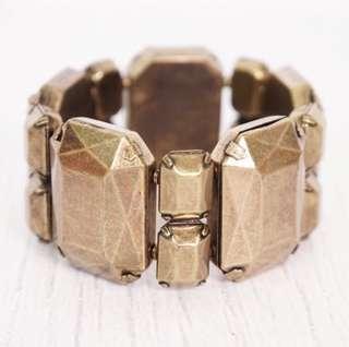 Gold arm bracelet