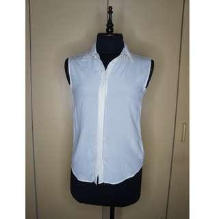 Uniqlo cream sleeveless top