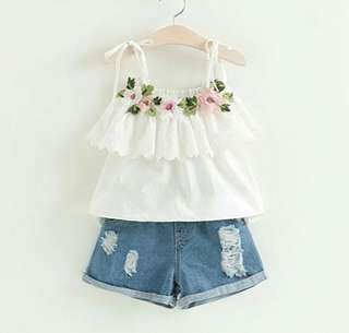 White floral spaghetti top with denim shorts
