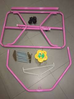 "Pink ""Sarung"" frame with wheels and motorised rocker with music"