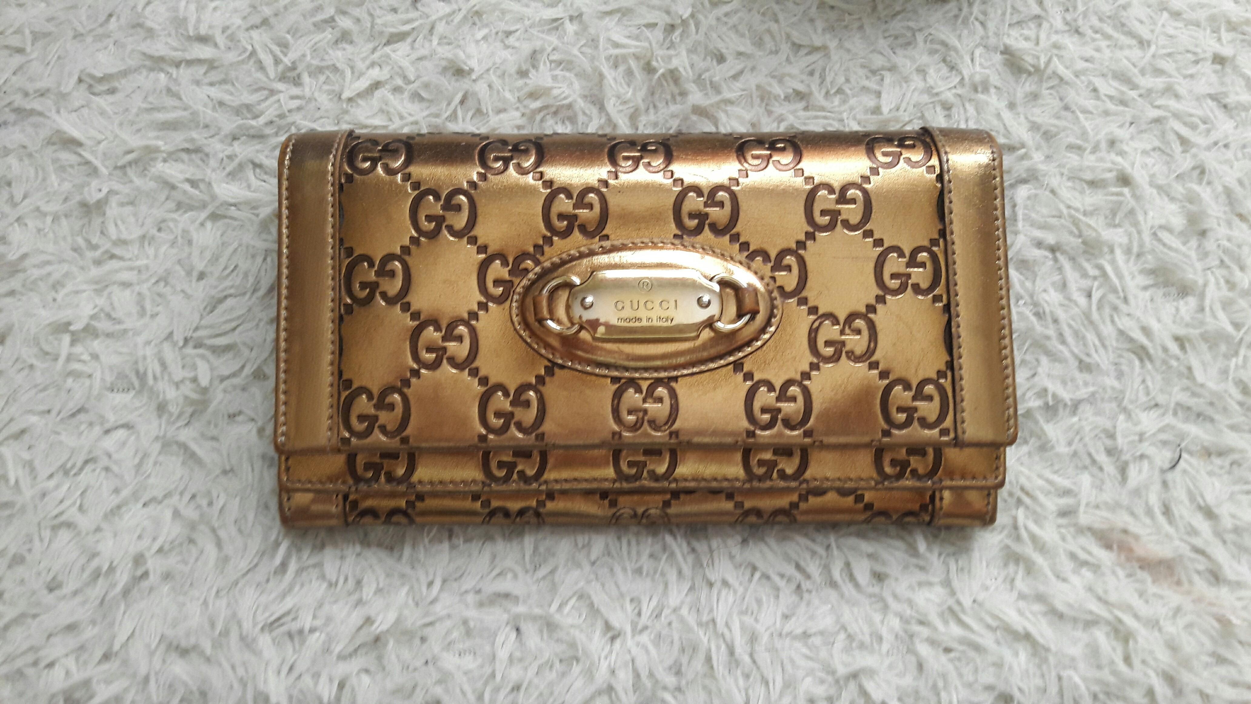 8172d8f017c Authentic gold gucci wallet