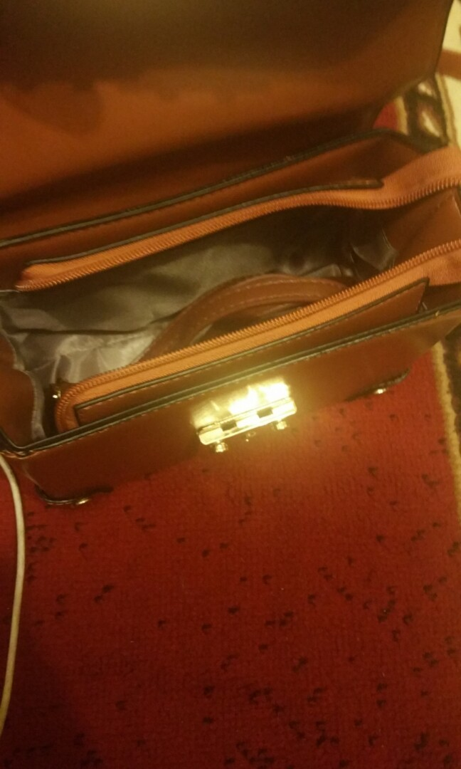 Tan box shape messenger bag with gold hardware & extra strap