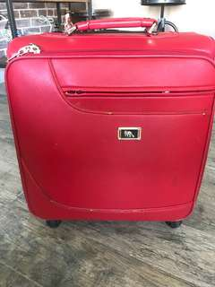 Red (small) suitcase)