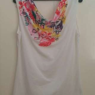 white sleeveless blouse with colorful print