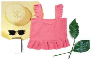 Ruffled pink blouse