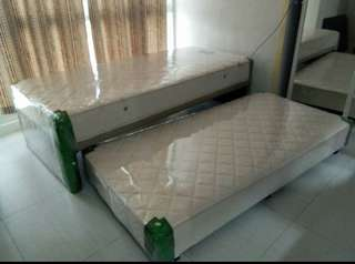 Single bed with pullout
