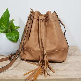 Marikai light tan bucket bag