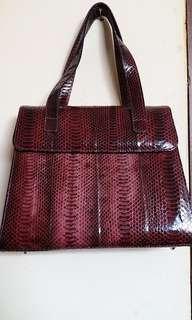 Purple snake leather motif bag