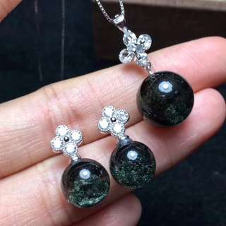 Pure silver inlaid with green ghost transport beads pendant.