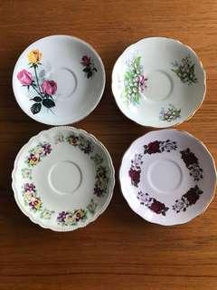Assorted bone china saucers