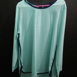 Puteri light blue blouse with dark blue borders
