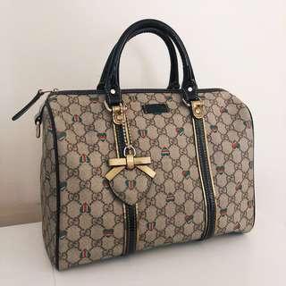 Gucci monogram duffle handbag bag with heart bar charm