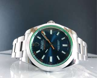 Pre owned Rolex Milguass blue dial green sapphire 116400GV