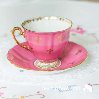 Stunning vintage fuschia pink and fleur de lis English bone china teacup and saucer