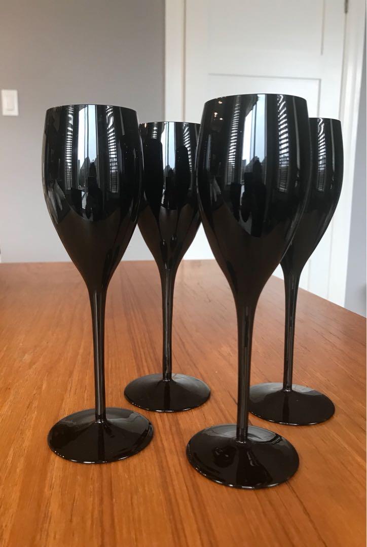 4 Small black glass wine glasses