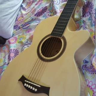 acoustic guitar with capo,case and, cord.