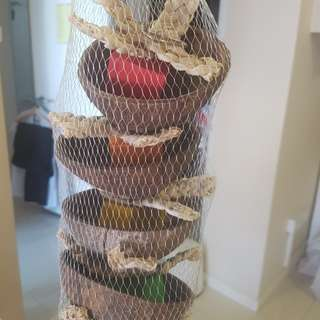 Coconut shell forage tower for birds