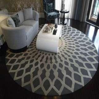 Gray round carpet