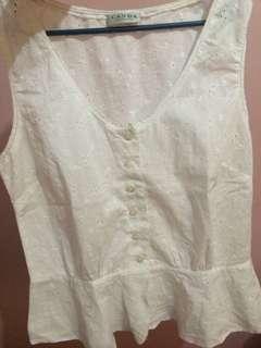 White peplum sleeveless top