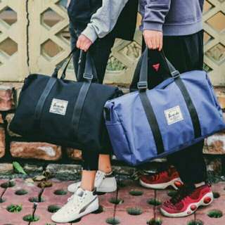 Herschel travelling bag (blue/black)