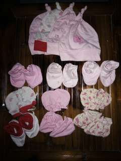 Hats, mittens and booties for baby girl.